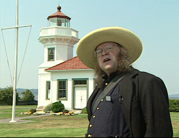 Man in front of Mukilteo lighthouse
