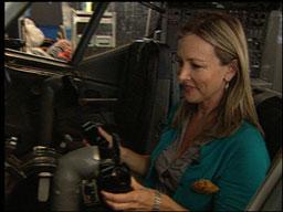 Sabrina Register sitting at airplane controls