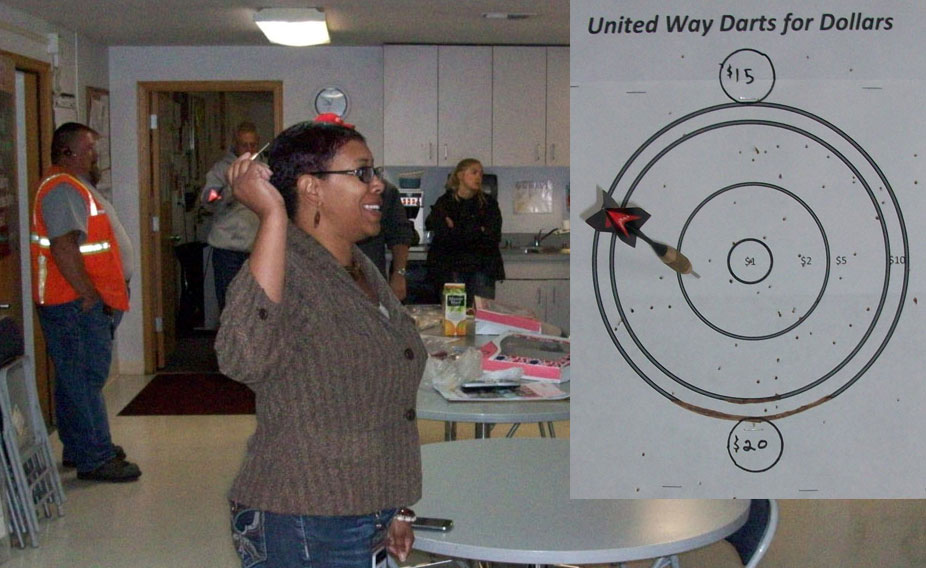 comcast employees play darts to raise money for United Way