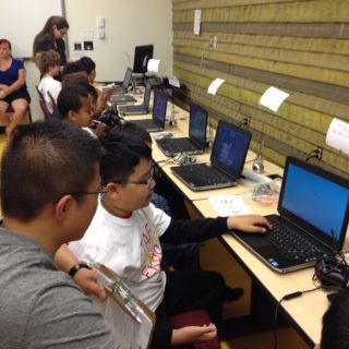 student showing screen to adult