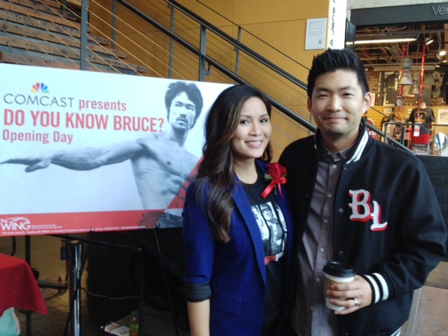 Comcast's Diem Ly and Phil Yu, award-winning blogger of Angryasianman.com, enjoy the Bruce Lee exhibit at the Wing Luke in Seattle.