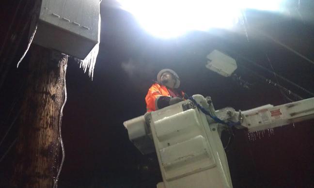 Comcast employee in bucket truck early Sat morning in Auburn