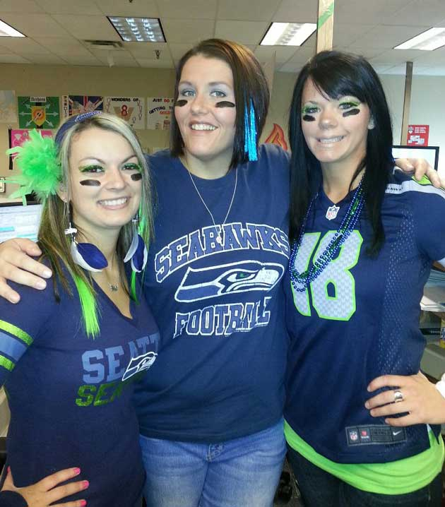 Comcast employees wear Seahawks colors to support United Way drive