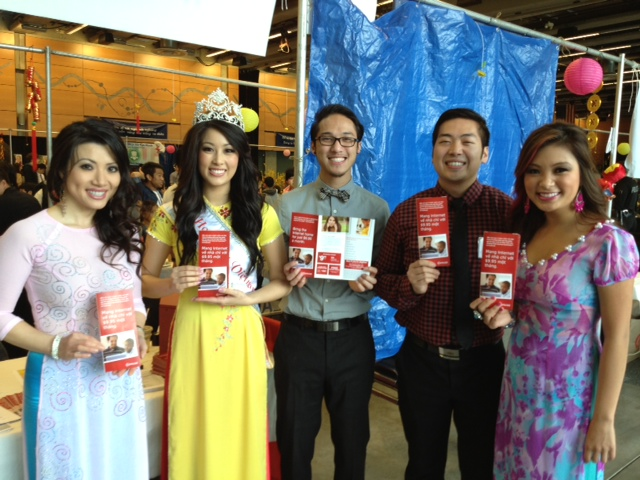 Vietnamese Lunar New Year festival coordinators hold up Internet Essentials brochures on Feb. 16 at the Seattle Center. From left to right: Samantha Hoang (Executive Director of Miss Vietnam Washington), Lynda Pham (Miss Vietnam Washington 2013), Elson Tran (Tet in Seattle volunteer), Joe Nguyen (Tet in Seattle volunteer), and Verlinda Vu (Tet in Seattle Public Relations).