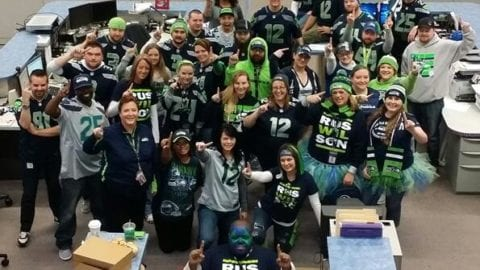 Fife call center employees dressed in Seahawks colors