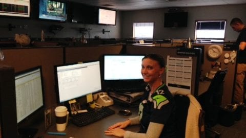 Jennifer Wolever sitting at her desk at the Everett XOC