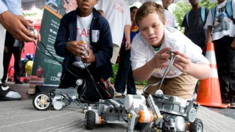 students driving small robots