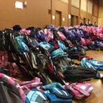 Photo of dozens of backpacks