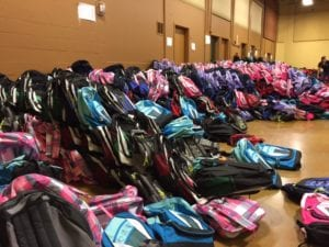 Photo of dozens of backpacks