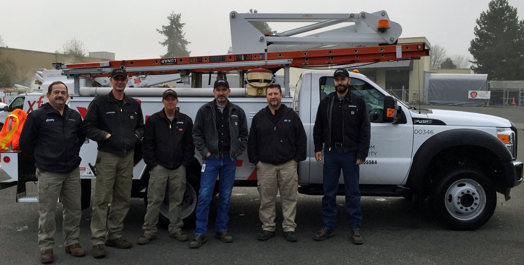 Techs standing by a truck