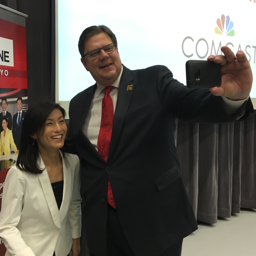 NHK World news anchor Minori Takao poses for a selfie with Bates Technical College President Dr. Ron Langrell.