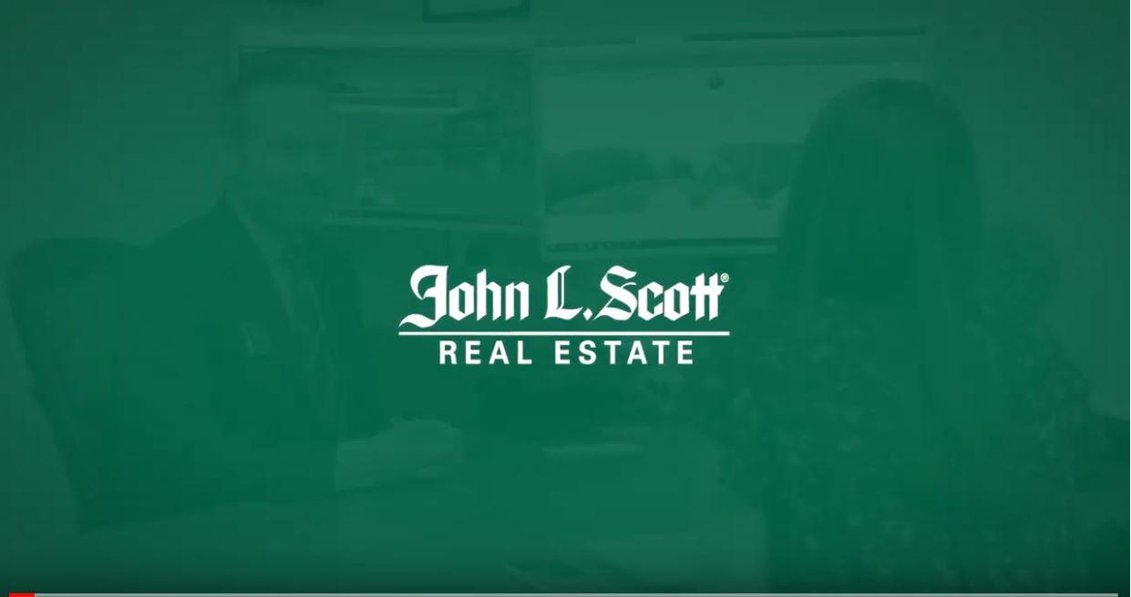The John L. Scott Real Estate logo.
